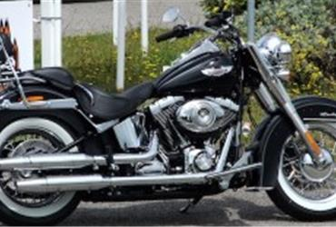 If you are on a business trip and rent a car to visit your company's branches or customers, why would you always choose a boring middle of the road kind of car? Depending on the climate on your destination, a convertible would add a nice touch to your trip or… why not rent a Harley-Davidson?